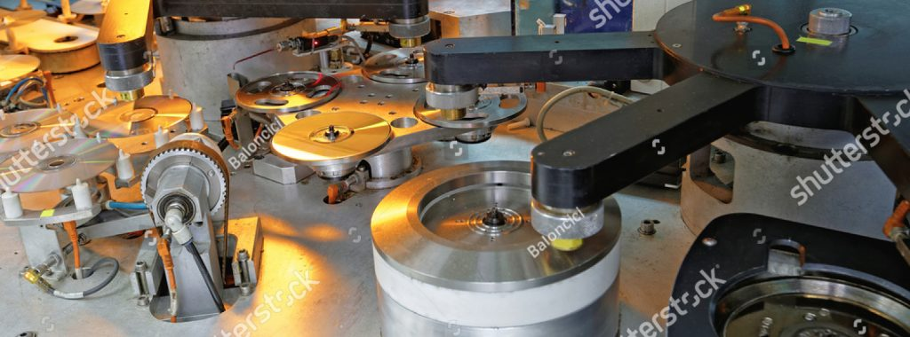 stock-photo-compact-disc-and-dvd-manufacturing-machine-219153076